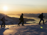 Skiers on Peak of Daltinden at Night Time in Midnight Sun Photographic Print by Christian Aslund