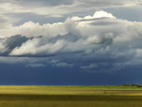 Storm Clouds Building over the Mara Savannah at Dusk Photographic Print by Doug McKinlay