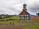 Children Playing Soccer in Front of Iglesia De Putchitco Church Photographic Print by John Elk III