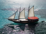 Aerial of Jolly Pirate Tourist Sail Boat Near Palm Beach Photographic Print by Holger Leue
