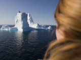 Woman Looking at Iceberg from Ilulissat Kangerlua Icefjord Photographic Print by Holger Leue