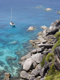 Sailboat and Snorkelers Near Granite Rocks Photographic Print by Holger Leue