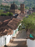 Cobblestone Street with Colonial Houses and Catedral De La Inmaculada Concepcion in Background Fotografisk tryk af Margie Politzer