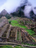 Fog Above Terraced Inca Ruins Photographic Print by Jeffrey Becom