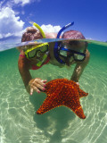 Two People Snorkelling with Starfish Photographic Print by Greg Johnston