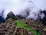 Inca Terraces with Fogbound Mountains Photographic Print by Jeffrey Becom