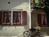 A Bicycle Leans Against the Wall in the Medieval Town of Rothenburg Ob Der Tauber Photographic Print by Bruce Esbin