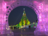 Illuminated Spaceship Ice Sculpture Framed by Arch at Ice Festival Photographic Print by Keren Su
