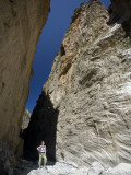 Hiker Beneath the Sheer Rock Walls of Samaria Gorge Photographic Print by Gareth McCormack