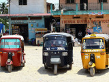 Taxis Parked Outside Local Shops Photographic Print by John Sones