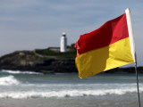 Lifeguards' Warning Flag and Godrevy Lighthouse Photographic Print by Doug McKinlay