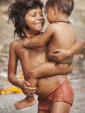 Big Sister Bathing Her Little Brother in Ganges River Photographic Print by April Maciborka