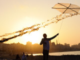 Kite Flyer Along the Corniche Photographic Print by Michael Benanav