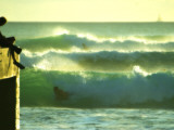 Green Afternoon Waves Off the Wall at Waikiki with a Boogie Boarder on the Side at the Wall Photographic Print by Ann Cecil