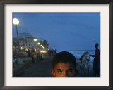 A Sri Lankan Boy Looks as He Sells Prawns at the Sea Front, in Colombo, Sri Lanka, June 30, 2006 Framed Photographic Print by Manish Swarup