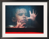 A Young Indonesian Boy Chases Raindrops on the Back Window of a Passenger Bus Framed Photographic Print