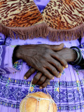 Folded Hands of Herero Woman in Traditional Dress Photographic Print by Tom Cockrem