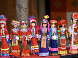 Dolls in Hill-Tribe Costumes for Sale at Sunday Market Photographic Print by Nicholas Reuss