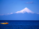 Boat on Lake Llanquihue Photographic Print by Roberto Gerometta