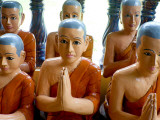 Statuettes of Buddhist Monks at Prayer Photographic Print by Philip Game