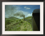 A Train is Seen Approaching Osier, Colorado, August 7, 2005 Framed Photographic Print by Deborah M. Baker