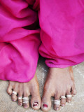Woman's Adorned Feet with Jewellery Worn to Balance on Each Side of the Bod Photographic Print by April Maciborka