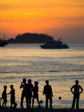 People on Patong Beach Silhouetted at Sunset Photographic Print by Austin Bush