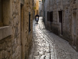 Scooter Riding Down Cobbled Backstreet Photographic Print by Will Salter