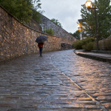 Pedestrian on Cobblestoned Street Photographic Print by Denis Corriveau