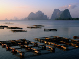 Aquaculture Ponds of Ko Panyi Muslim Village, and Karst Islands of Ao Phang-Nga Bay Photographic Print by John Elk III