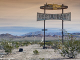 Old Restaurant Sign at Route 66 Near Chambless with Marble Mountains in Distance Stampa fotografica di Witold Skrypczak