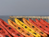 Orange and Red Rental Kayaks on Beach Photographic Print by Pascale Beroujon