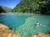 Visitors Swimming in Turquoise-Coloured Waters of Semuc Champey Fotografisk tryk af Paul Kennedy