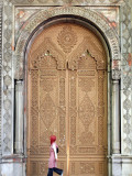 Young Turkish Woman Walking Past an Ornate Doorway in Ortakoy Photographic Print by Tim Hughes