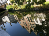 Facades of Old Gabled Townhouses Reflected in Canal Photographic Print by Krzysztof Dydynski