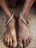Detail of Old Woman's Feet with Ankle Bracelets Photographic Print by April Maciborka