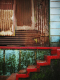 Detail of Red Stairs and Corrugated Tin Wall Photographic Print by April Maciborka
