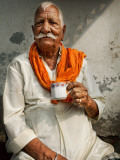 Man Drinking His Afternoon Chai Photographic Print by April Maciborka