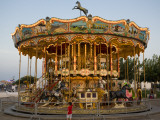Merry-Go-Round at Saintes-Maries-De-La-Mer Photographic Print by Manfred Gottschalk