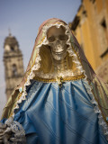 Skeleton Adorned as Virgin Mary Photographic Print by Sean Caffrey