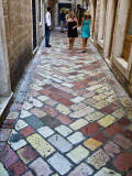 People on Cobblestones in Stari Grad (Old Town) Photographic Print by Richard l'Anson