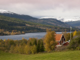 Traditional Wooden Barn with Snowy Fjells in Background Photographic Print by Christer Fredriksson