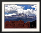 The Sun Breaks Through the Clouds to Highlight the Summit of Pikes Peak Framed Photographic Print