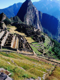 Ruins of Machu Picchu with Huayna Picchu in Background, Seen from Funerary Rock Steps Photographic Print by Anthony Pidgeon