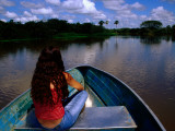 Woman in Bow of Boat on Cano Mata'E Rancho, Hato La Fe Ecotourist Ranch Photographic Print by Krzysztof Dydynski