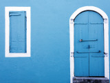 Blue Building with Closed Wooden Window Shutters and Door Photographic Print by Richard Cummins