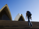 Backpacker Climbing Steps of Sydney Opera House Photographic Print by Andrew Watson