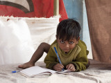 Boy Writing in Notebook Photographic Print by April Maciborka