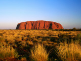 Uluru (Ayers Rock) with Desert Vegetation Photographic Print by John Banagan