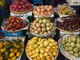 Display of Tropical Fresh Fruit in Market, Including Rambutans, Mangoes, Longans and Dragon Fruit Fotodruck von Anders Blomqvist